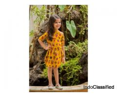 Get Yellow cotton printed kids frocks from Mirraw